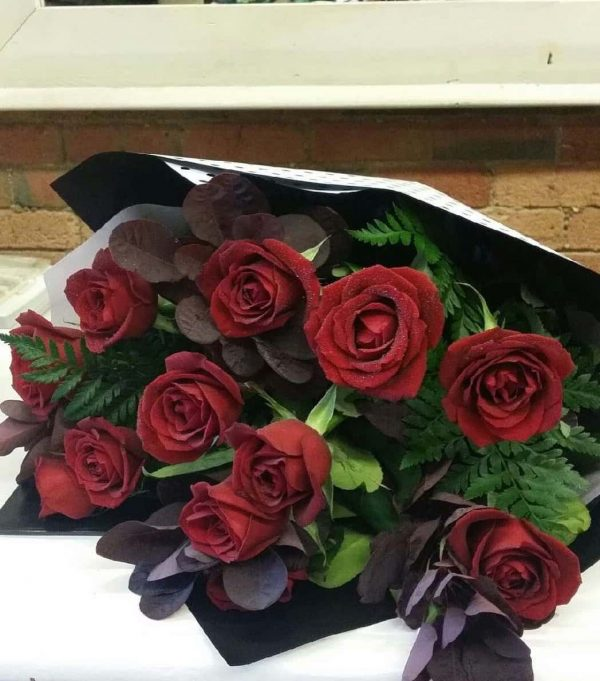 Red Roses in a black wrap