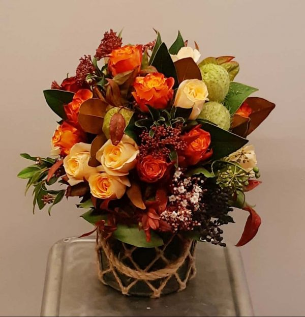 Flower bouquet in a rope vase