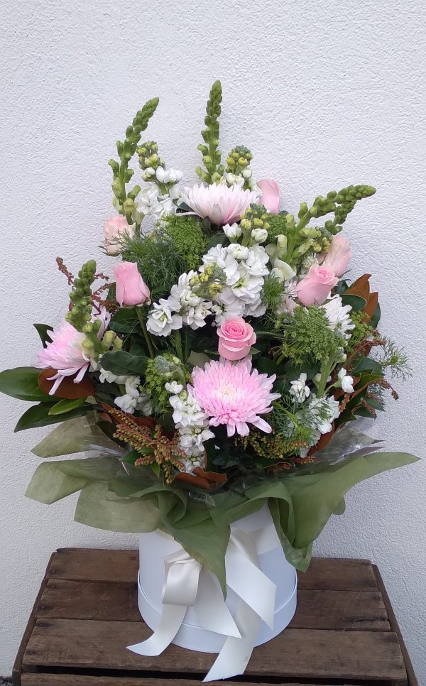 Pink Flowers on White Pot Arrangement
